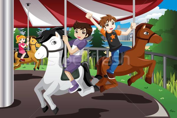 Kids Riding on Merry Go Round Stock photo © artisticco