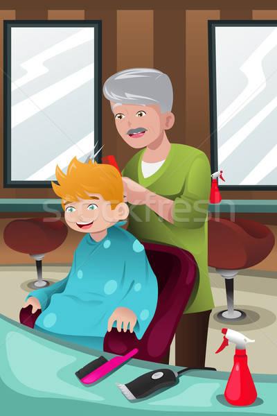 Kid getting a haircut Stock photo © artisticco