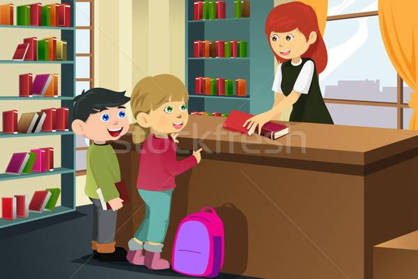 Gyerekek kölcsönvesz könyvek könyvtár boldog fiú Stock fotó © artisticco