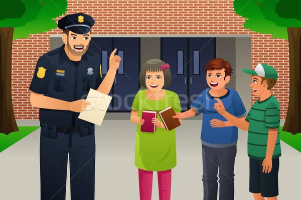 Policeman Talking to Kids Stock photo © artisticco