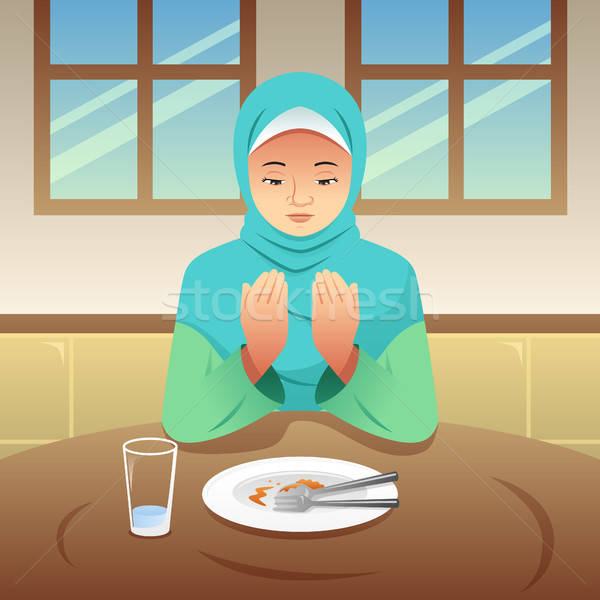 Muslim Woman Praying After Eating Stock photo © artisticco