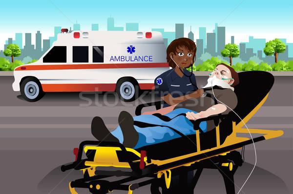 Femenino paramédico examinar paciente de trabajo Trabajo Foto stock © artisticco