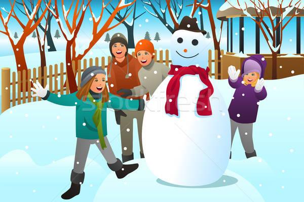 Enfants adolescents amis bâtiment bonhomme de neige enfants Photo stock © artisticco