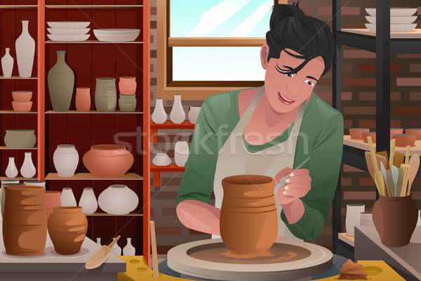 Young woman working on a pottery Stock photo © artisticco