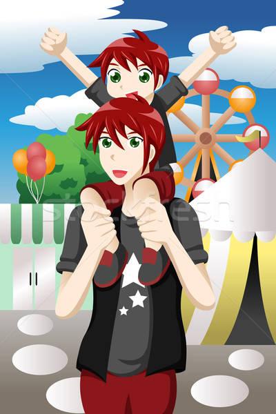 Father son at amusement park Stock photo © artisticco