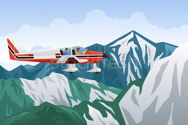 Small Airplane Flying Across the Mountains Stock photo © artisticco