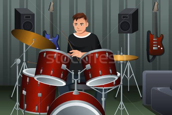 Uomo giocare tamburo studio sorriso giovani Foto d'archivio © artisticco
