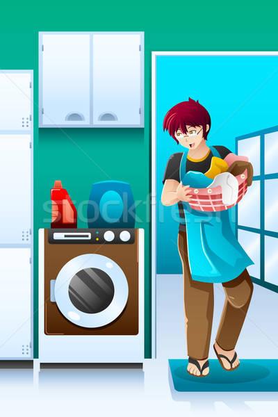 Man doing laundry Stock photo © artisticco