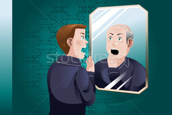 Young Man Looking At an Older Himself in the Mirror Stock photo © artisticco