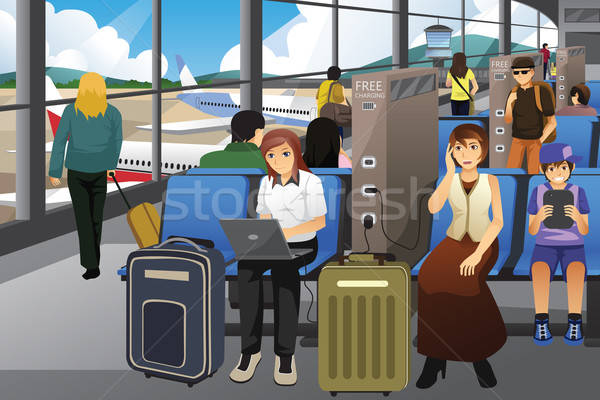 Travelers Charging Their Electronic Devices in an Airport Stock photo © artisticco