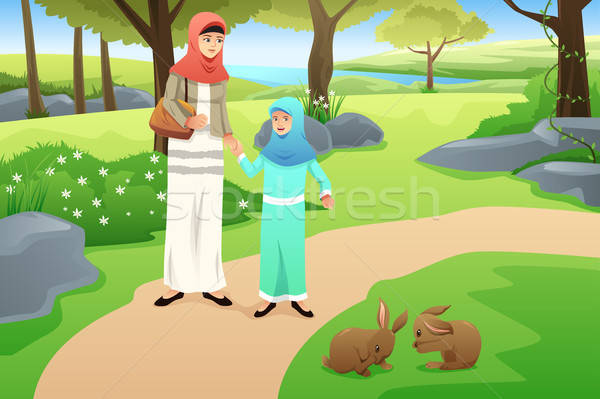 Muslim Girl and Her Mother Walking in a Park Stock photo © artisticco