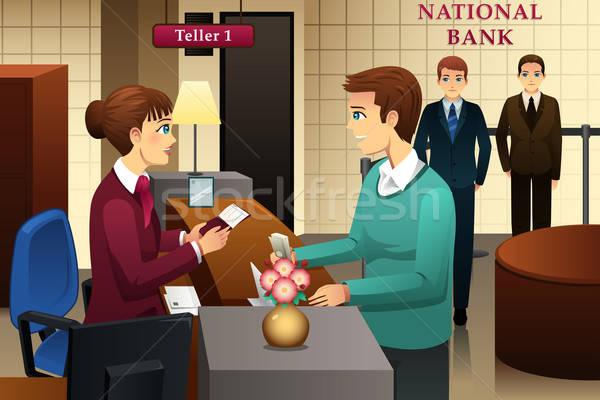 Bank teller servicing a customer in the bank Stock photo © artisticco