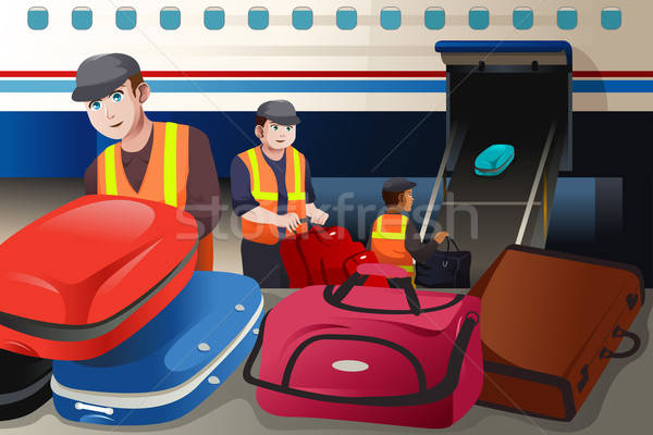Workers loading luggage into an airplane in the airport Stock photo © artisticco