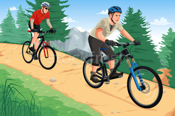 People riding mountain bikes Stock photo © artisticco