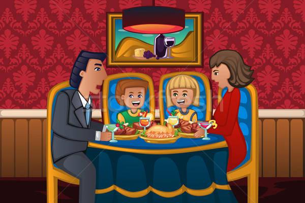 семьи еды обеда вместе счастливая семья девушки Сток-фото © artisticco