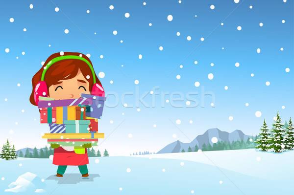 Fille heureuse Noël présente neige fille Photo stock © artisticco
