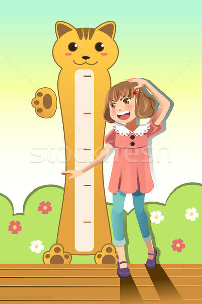 Girl measuring her height Stock photo © artisticco