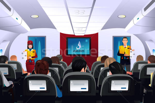 Flight attendant showing safety procedure to passengers Stock photo © artisticco