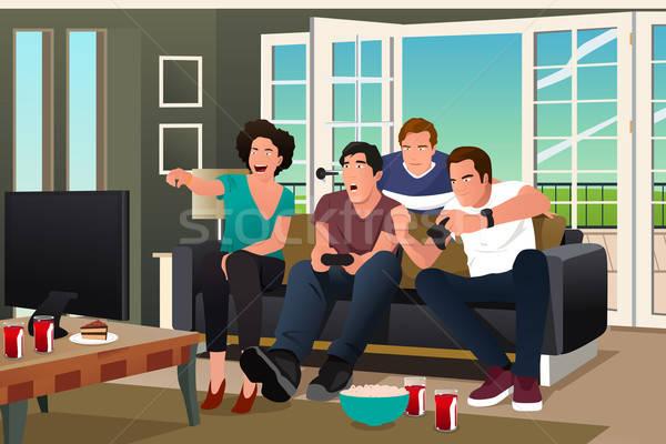 Adolescents jouer jeu vidéo amis regarder femme Photo stock © artisticco