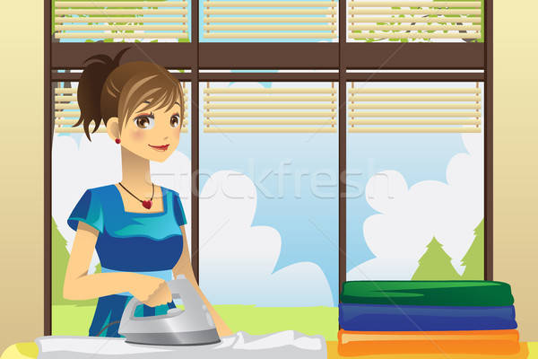 Housewife ironing clothes Stock photo © artisticco