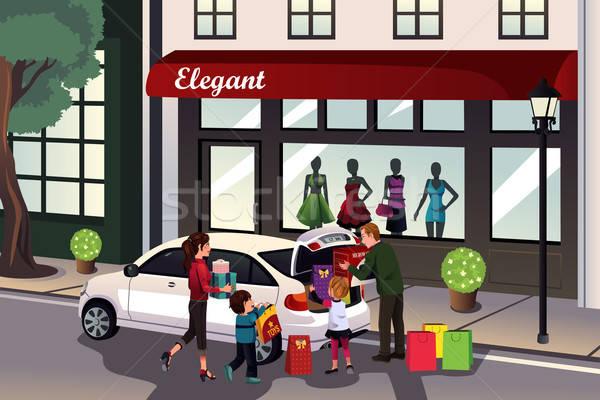 Family loading shopping stuff into the car Stock photo © artisticco