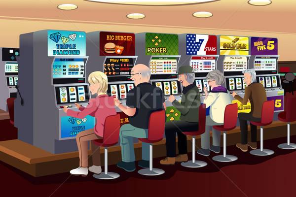 Idős emberek játszik rés gépek kaszinó Stock fotó © artisticco