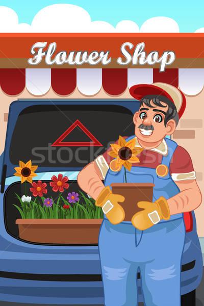 Man Loading Flowers into Van Stock photo © artisticco