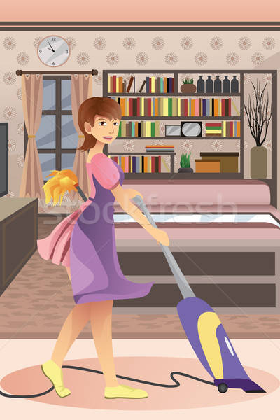 Stock photo: Happy woman vacuuming carpet