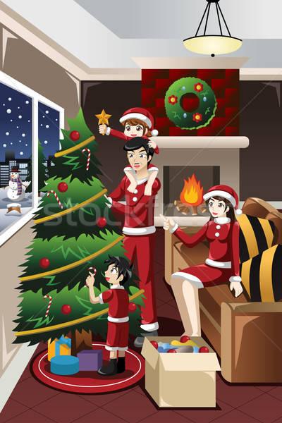 Gyerekek segít szülők karácsonyfa együtt ház Stock fotó © artisticco