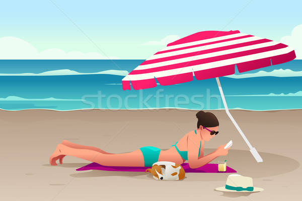Woman Sunbathing on the Beach Stock photo © artisticco