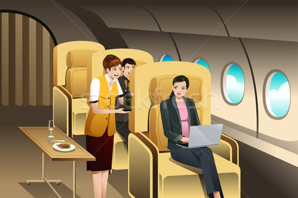 First Class Passengers Being Served by the Flight Attendant Stock photo © artisticco