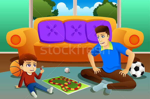 Father and Son Playing Board Game at Home Stock photo © artisticco