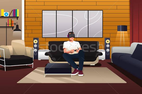Homem jogar virtual realidade fone sala de estar Foto stock © artisticco