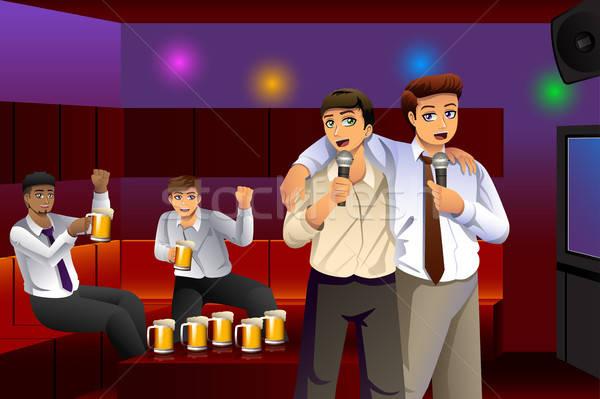 Empresarios cantando karaoke trabajo diversión alcohol Foto stock © artisticco