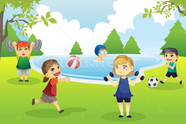 Kids exercising in park Stock photo © artisticco