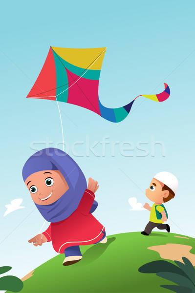Moslim kinderen spelen Kite outdoor meisje kinderen Stockfoto © artisticco