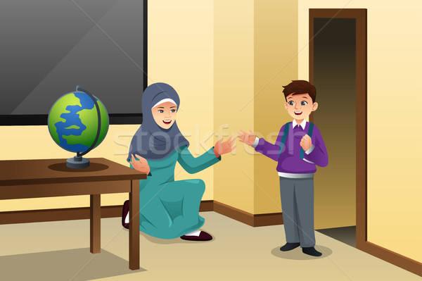 Muszlim gyerek tanár osztályterem iskola gyermek Stock fotó © artisticco