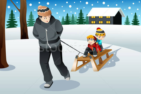 Father pulling his sons riding on a sled Stock photo © artisticco
