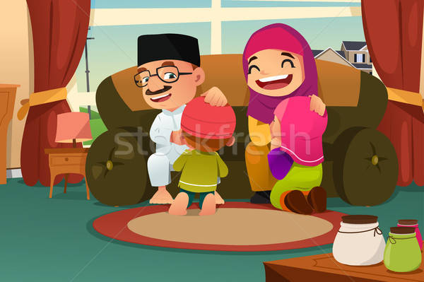 Muslim Family Celebrating Eid Al Fitr Stock photo © artisticco
