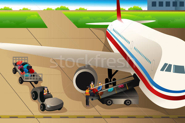 Workers loading luggages into an airplane in the airport Stock photo © artisticco