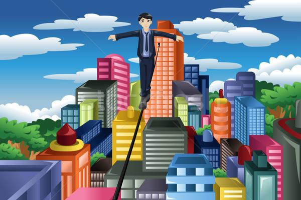 Empresário equilíbrio apertado corda negócio jovem Foto stock © artisticco