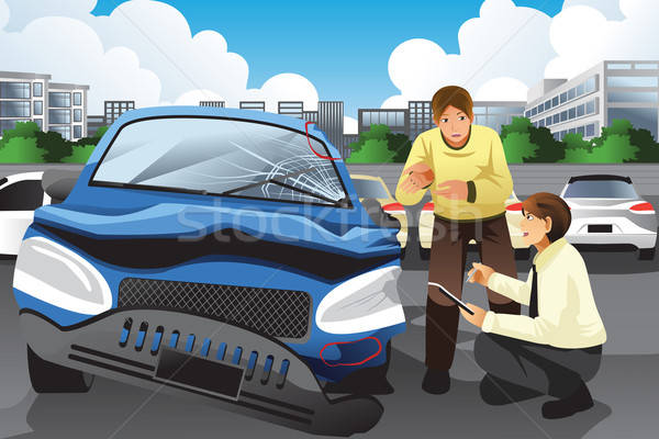 Insurance agent assessing a car accident Stock photo © artisticco