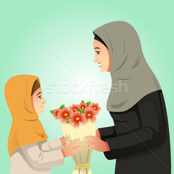 Muslim Girl Giving Flowers to Her Mother Stock photo © artisticco