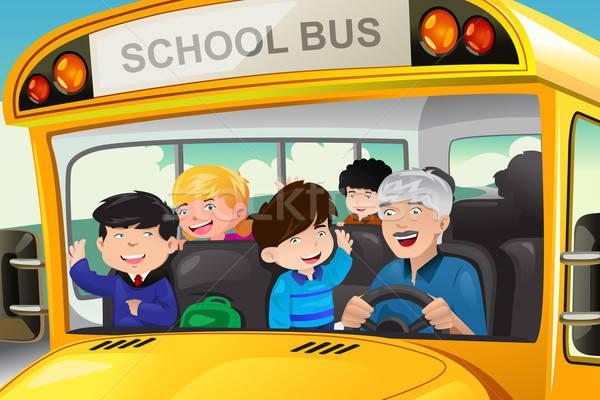 Kids having fun in a school bus Stock photo © artisticco