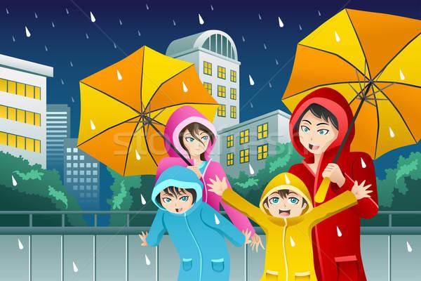 Család sétál esernyő visel nagy város Stock fotó © artisticco