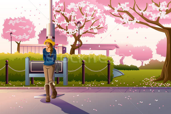 Girl Walking During Cherry Blossom Stock photo © artisticco