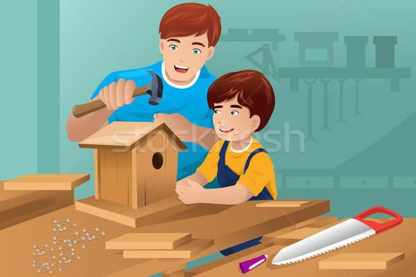 Father son making a birdhouse Stock photo © artisticco