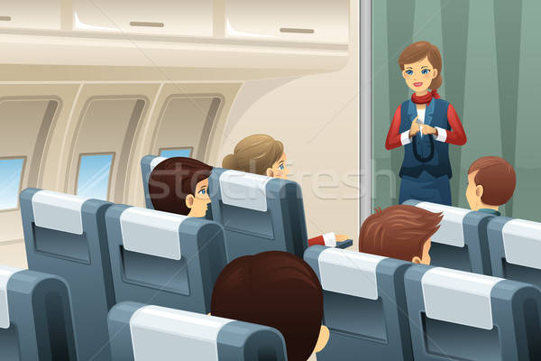 Flight attendant demonstrate how to fasten the seat belt  Stock photo © artisticco