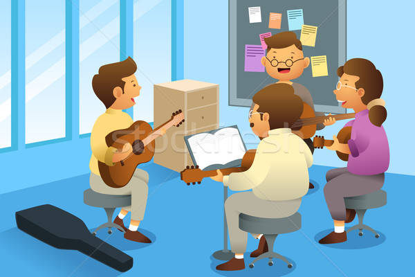 Сток-фото: взрослых · гитаре · класс · улыбка · мужчин · молодые