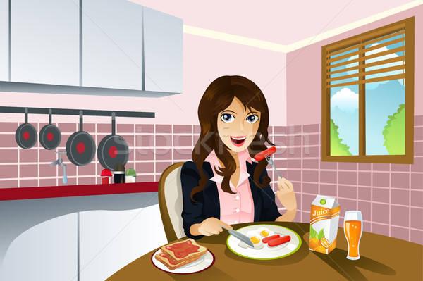Kadın yeme kahvaltı güzel bir kadın ev gün Stok fotoğraf © artisticco
